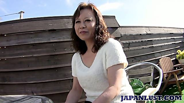 Mature Japanese lady Akemi Seo rides dick and gets her soaking slit stretched well