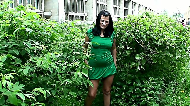 Hot looking brunette harlot Vika shows off her treasures in the street