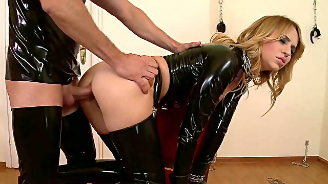 Sex hungry couple in latex suits present hot sex on the floor