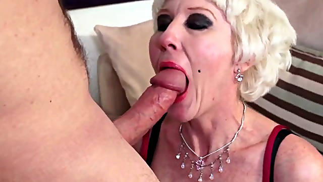 Old slut Dalny Marga guzzles juicy cock standing on knees