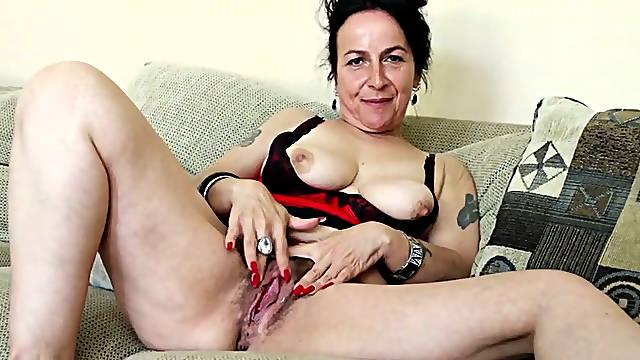 Lusty brunette mommy Miss Nina Swiss masturbates her huge pussy