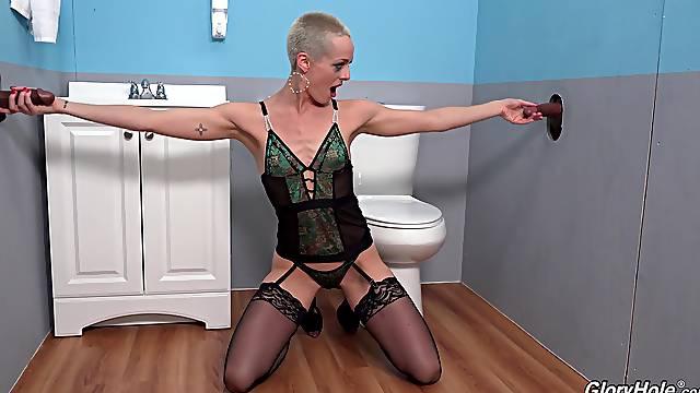 Skinny bald beauty Sidra Sage loves gloryhole antics with two dicks