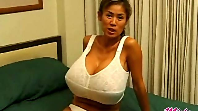 Minka models her new bra in a Korean hotel room