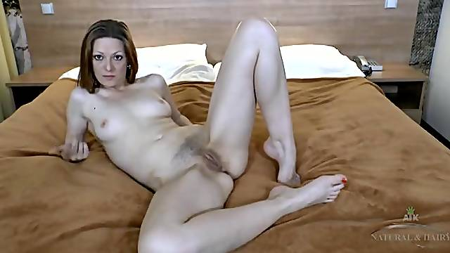 Hairy pussy babe at home filming her cunt and feet