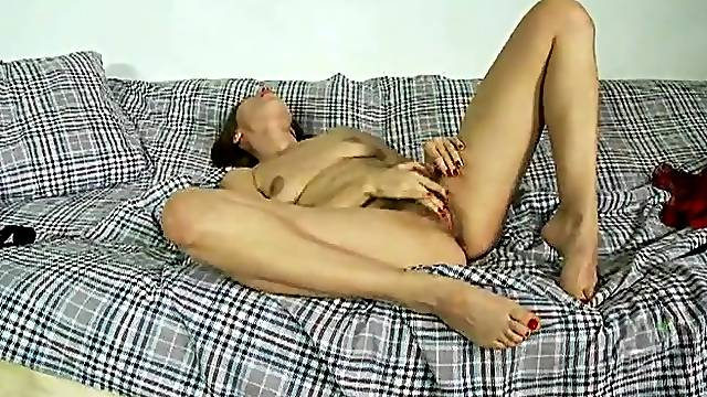 Naked skinny chick with a glorious hairy pussy