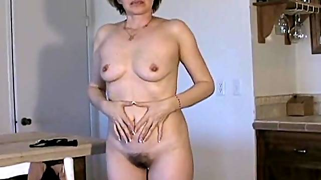 Amateur mature chick has a nice bush and perky tits