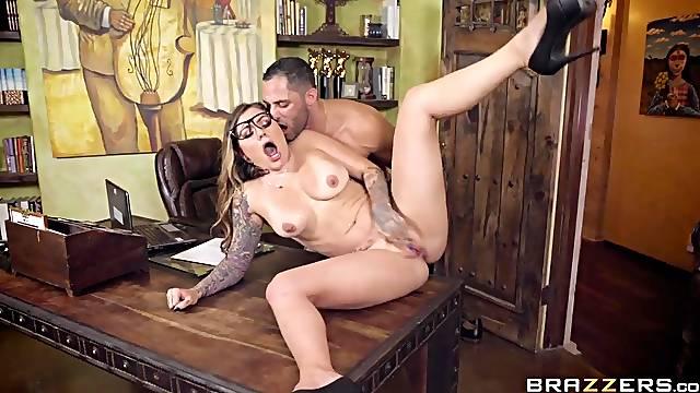 Tattooed secretary slut on a desk gets pounded so hard