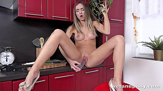 Cutie crams a big dildo into her slick shaved pussy