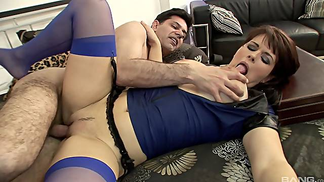 Mature in sexy uniform performs magic on a big dick