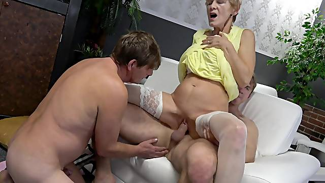 Yvonne is reminded of her youth as she opens up her cunt to two guys