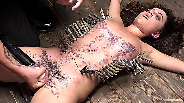 Teen babe gets covered in wax during a pretty harsh BDSM play