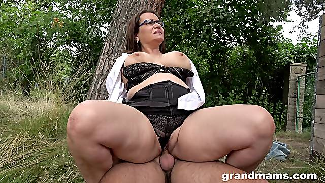 Chubby ass mature enjoys cock in the back of the house