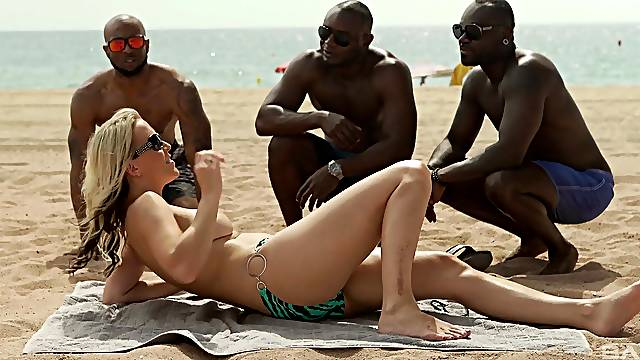 Julia Pink attracts attention on the beach before interracial gangbang