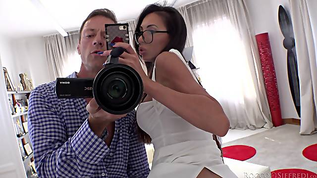 Busty brunette goes nuts while fucking Rocco Siffredi