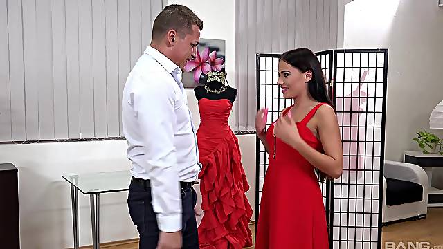 Energized brunette tries a new dress and a new cock