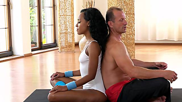 Ebony babe is set to devour the man's big white during Yoga class