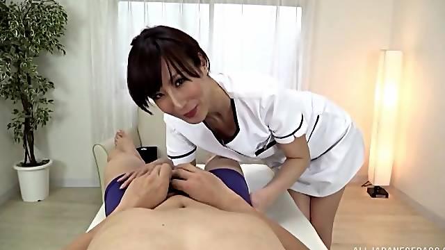 Frisky Asian Reiko Sawamura strokes a guy and pegs his ass