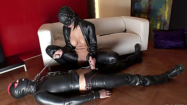 Dominant woman in latex costume, intriguing femdom