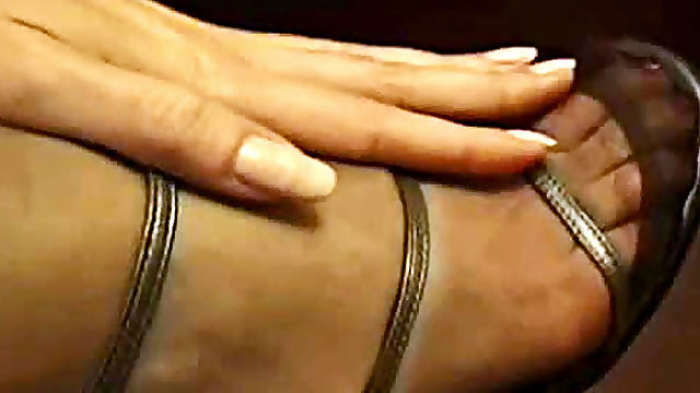Secretary with nylon clad feet in heels