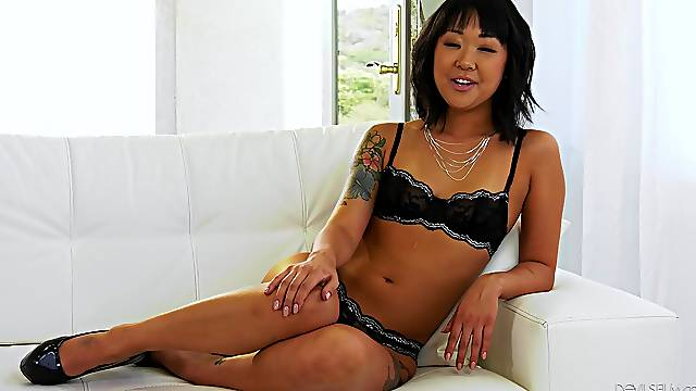 Asian in sexy lingerie talks dirty about her sexual fantasies