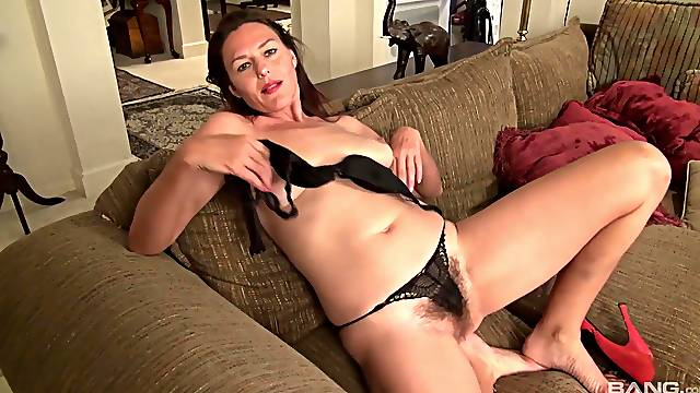 Mature strips on cam and plays with her hairy cunt like a whore