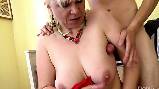 Hannah, a horny mature broad, has some fun with a hung young buck