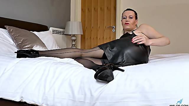 Mature in sexy leather dress, insolent home solo on cam