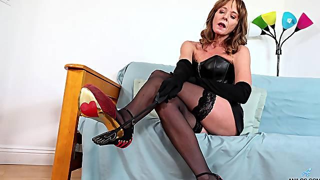 Appealing mature in black lingerie, seductive domination act