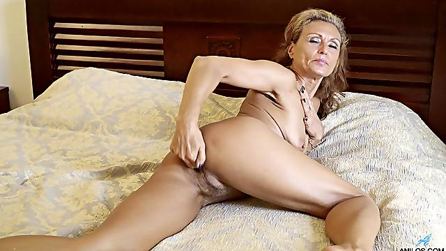 Mature fingers the hairy cunt in remarkable solo scenes