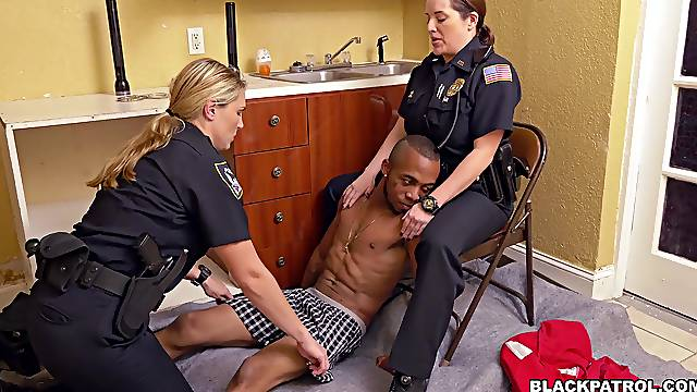 Female cops share young black guy's cock in a dirty play