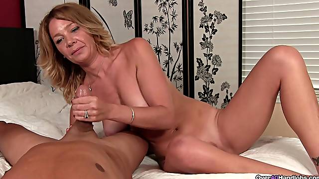 Naked mature gives a crazy handjob to her horny stepson