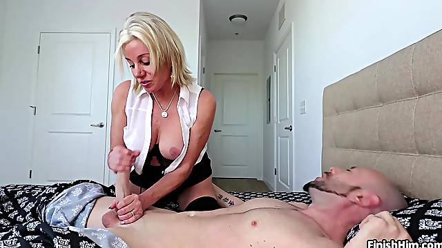 Young lad fufills fantasies of having his mom giving him a handjob