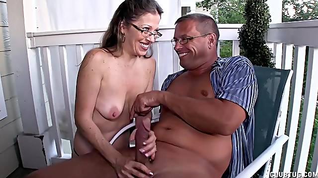 Amazing mature shakes this man's cock in amateur scenes of real handjob