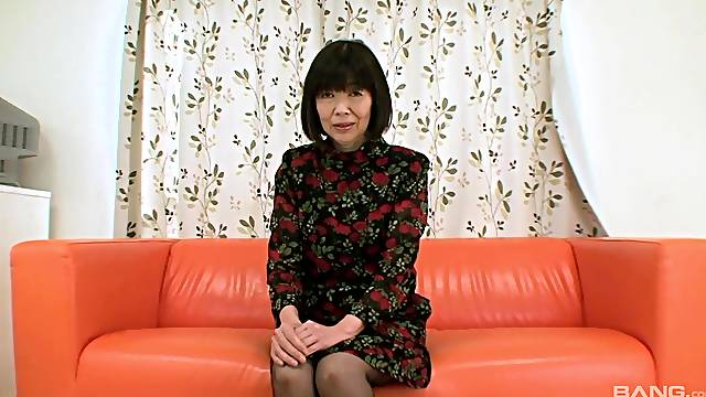 Nude mature inserts massive cock into her hairy Japanese cunt