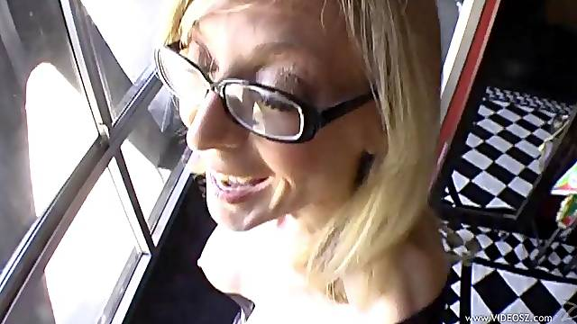 MILF in glasses working on a beefy cock and gives blowjob in POV
