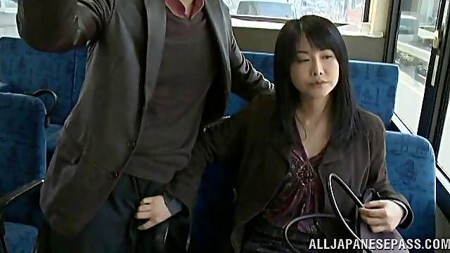 Japanese bitch lets a guy rub her pussy in a car in reality clip