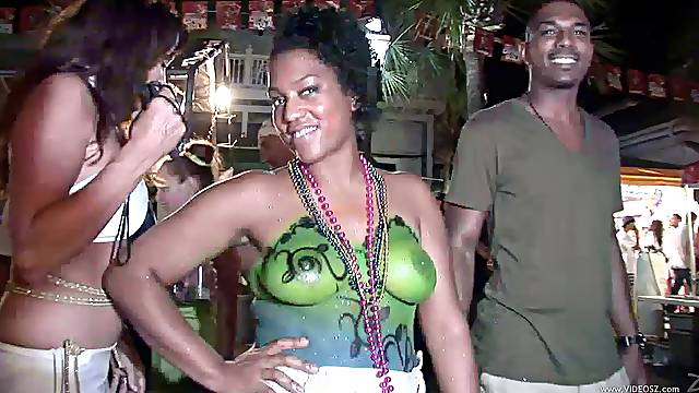 Lusty bitches with piercing show their natural tits in public