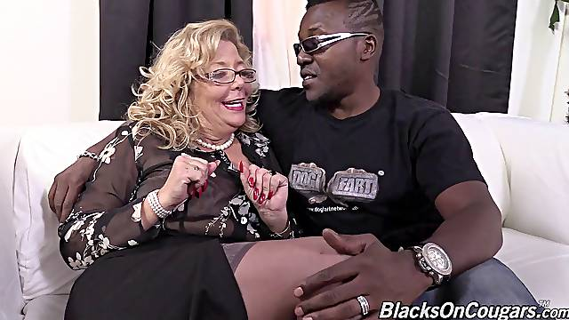 A black guy fucks a white granny then cums on her mature face