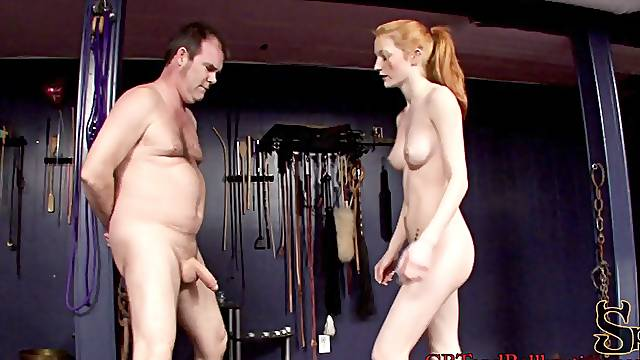 Hot redhead chick enjoys playing with stud's cock roughly in femdom movie