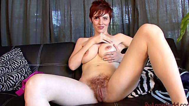 Cuddly solo model fingers her hairy pussy close up while masturbating