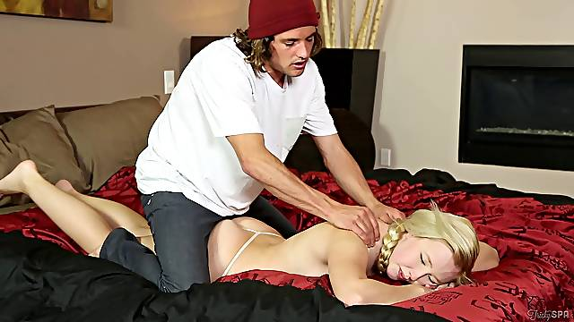 A cute blonde in pigtails gets a back rub and a pussy pounding