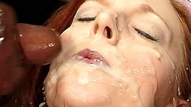 Redhead slut in a ripped pantyhose encounter a hot bukkake on her face