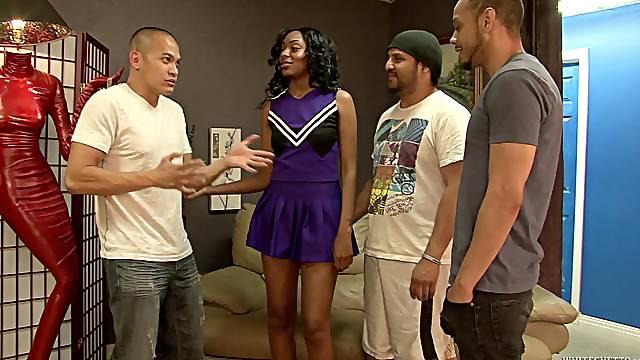 Nova Star is a black cheerleader enjoying three dicks