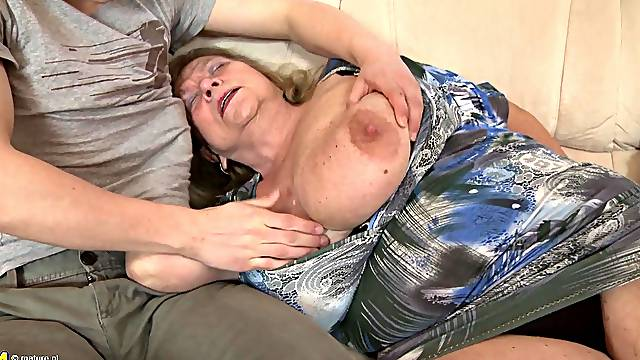 Massive granny titties jiggling as the guy fucks her pussy