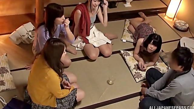 Handsome Japanese chicks team up to pleasure one rock hard guy