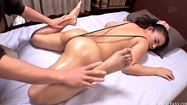 Oiled girl Oda Make gets her pussy massaged with a vibrator