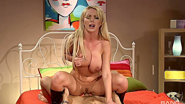 Nikki Benz strokes a big hard cock before she mounts and rides it