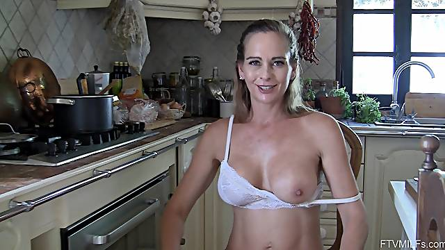 Strip tease and pussy fingering in the kitchen with solo model Eve