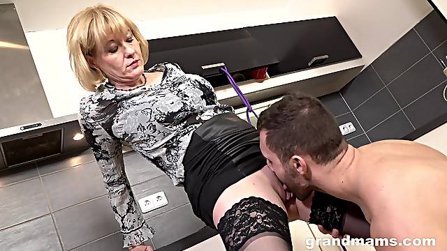Mature blonde abused in the kitchen wearing lingerie