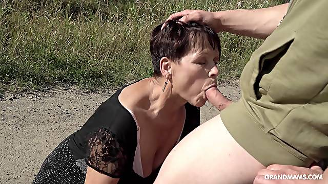 Granny with short hair fucked on the car by handsome stranger